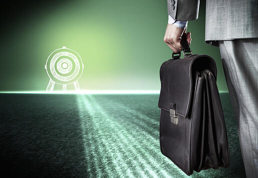 Bottom view of businessman with suitcase in hand